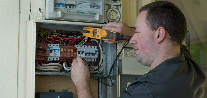 Technician looking at switch board